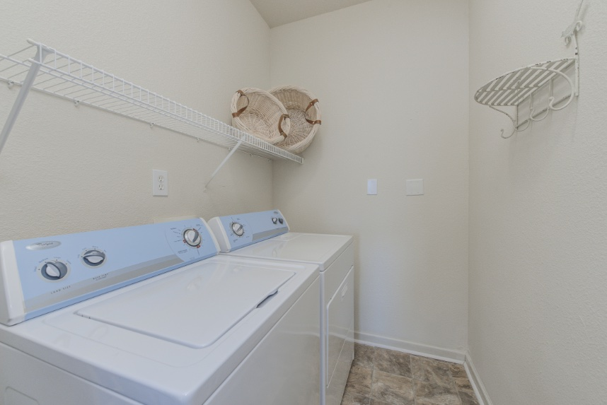 Laundry room with storage space in Carmel.